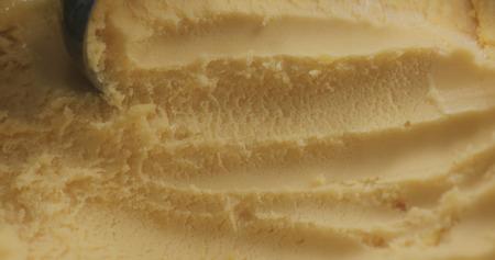 closeup scooping orange sorbet, wide photo Zdjęcie Seryjne