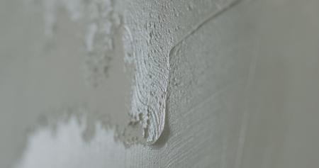 closeup applying decorative concrete plaster on the wall Stock Photo