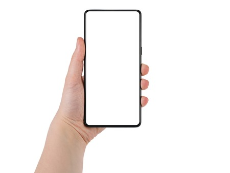 Young female hand holding bezel-less smartphone white screen isolated on white background, template