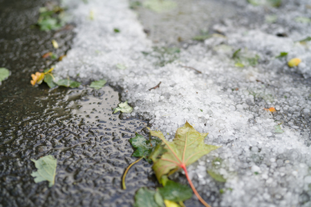 street covered with hailstones after hailstorm