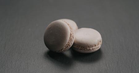 beige macarons on slate board, wide photo