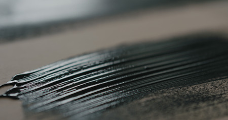 closeup of painted black plywood, wide photo 版權商用圖片
