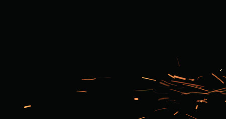 hot sparks floating from side on black background, wide photo 版權商用圖片