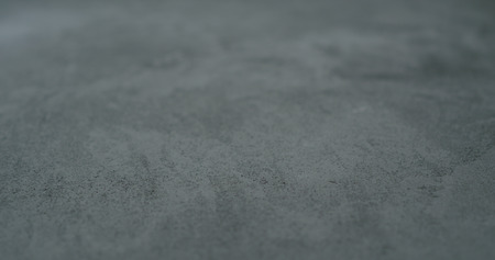 decorative dark concrete background with shallow focus Stock Photo