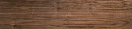 Black walnut wood texture of solid board oil finished 免版税图像