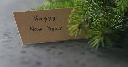 happy new year card next to spruce twig Stok Fotoğraf