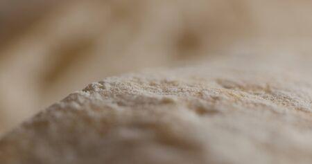 Extreme closeup of cutting ciabatta bread Фото со стока