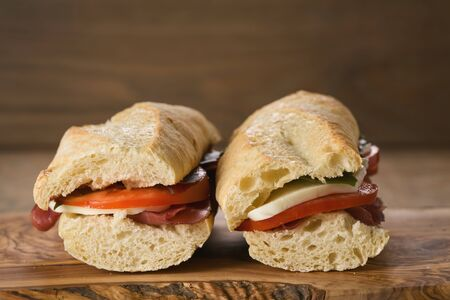 two homemade italian sandwiches with bresaola and mozzarella 写真素材