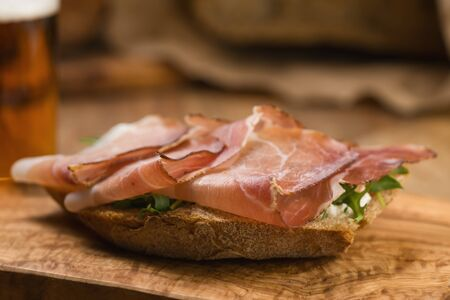 italian sandwich with speck and arugula , shallow focus
