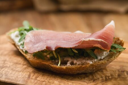 italian sandwich with speck and arugula , shallow focus Reklamní fotografie - 133484299