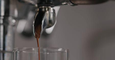 making espresso with single spout portafilter, wide photo