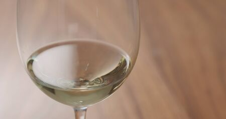 white wine in wineglass on table closeup