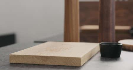 empty oak wood board for steak on concrete countertop