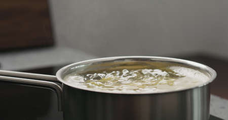 potato wedges boiling in saucepan Stok Fotoğraf