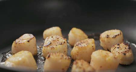 frying scallops on a ceramic pan