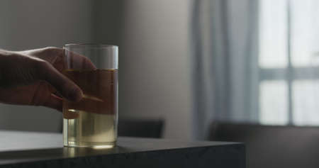 man take soda drink in highball glass from concrete countertop with copy space Stok Fotoğraf