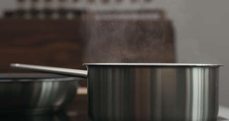saucepan with boiling water with copy space