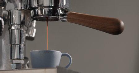 espresso brew into blue ceramic cup