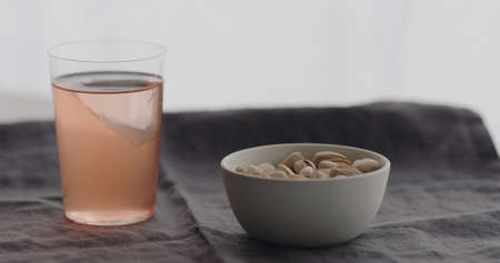 peach lemonade served with salted pistachios