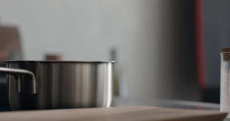 steam rising from saucepan with boiling water on stove
