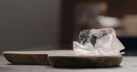 ice rocks on olive wood board