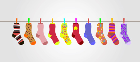 sock: vector colorful socks on gray background are hanging on rope. Christmas stocking