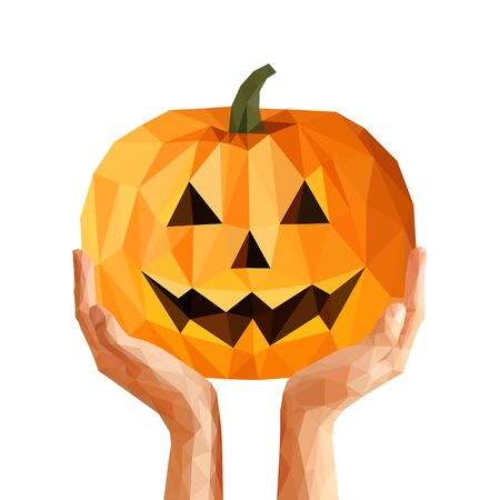 smilling: low poly polygon pumpkin for Halloween is on the hands Stock Photo