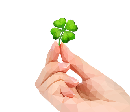 polygonal hand studio photo keeps four-leafed clover luck leprechaun in the fingers