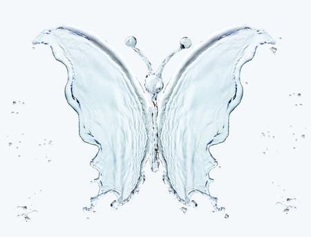 Butterfly made of water splashes isolated on light blue background