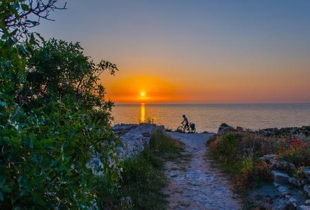 Cyclist at sunset  Sunset, Sevastopol,Crimea