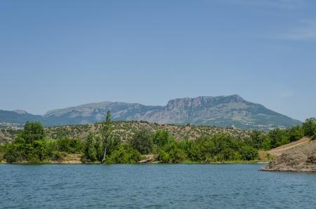 Vineyards at bottom of mountain