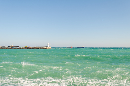 Sea embankment and lighthouse in Yalta. Yalta is a popular Crimean resort. Crimea. Ukraine. Russia.