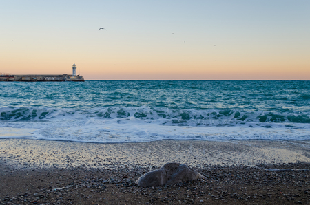 Beacon in Yalta at sunrise, a view from the central city embankment, Crimea. Russia Stock Photo