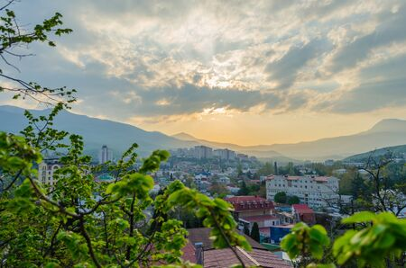 Sunset in the city of Alushta on the background of the mountains. Crimea.