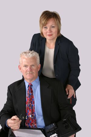 man and woman in business suits working as a team