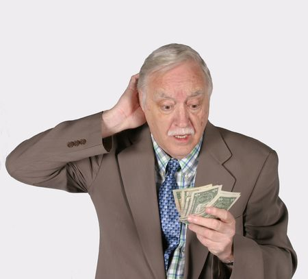 senior mature man with money looking confused Stock Photo