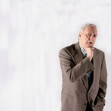 mature senior man in business suit thinking Stock Photo - 650585