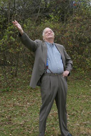 senior elderly mature man looking up to heaven smiling