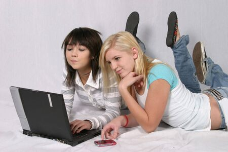 studied: blonde and brunette teenage girls surfing the Internet