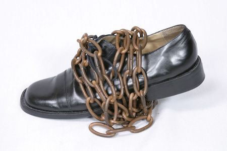 black oxford dress shoe wrapped in bronze chain Stock Photo - 659662