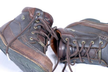 work boots: pair of worn brown rugged work boots