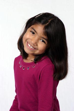 arab teen: cute black hair brown eye little girl smiling Stock Photo