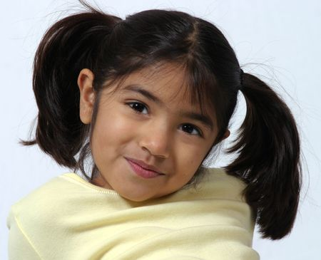 cute dark haired girl with pigtails smirking