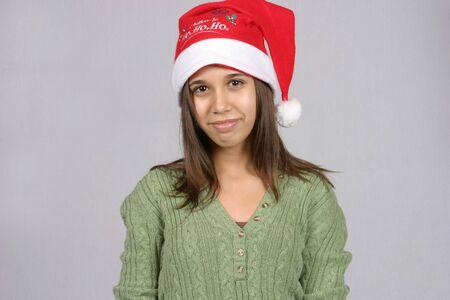 cute latina girl smiling in santa hat photo