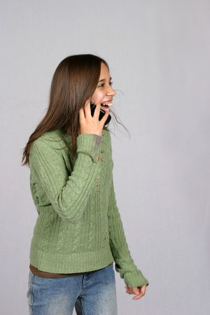 cute brunette girl on cell phone laughing photo