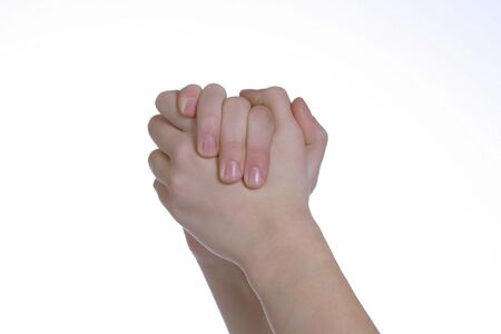 two caucasian hands clasped together on white space photo