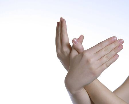 two caucasian hands on white background intertwined photo