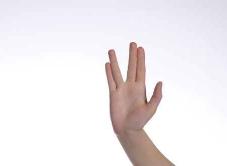caucasian hand giving signal for live long and prosper Standard-Bild