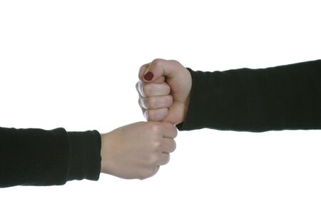 two caucasian hands on white space tapping fists photo