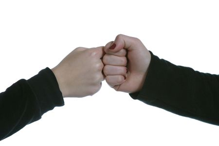 two caucasian hands touching with closed fists photo